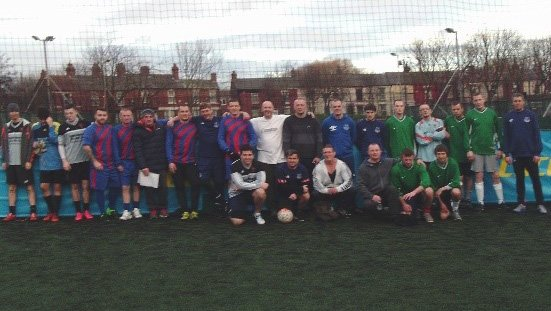 Footballers from homelessness services across Liverpool pose together