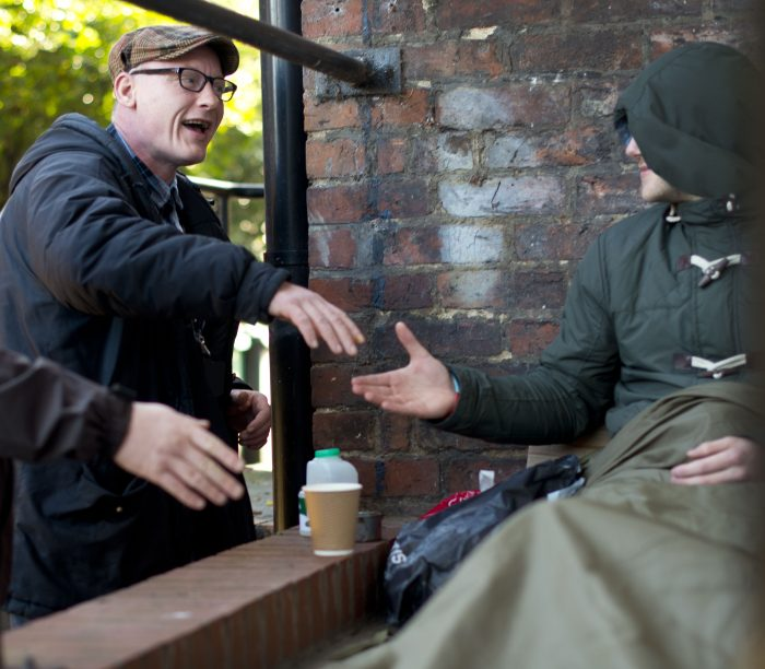 Street Buddies outreach volunteer greeting rough sleeper