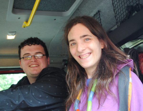 Residents of a supported living service sit in a fire engine on an open day