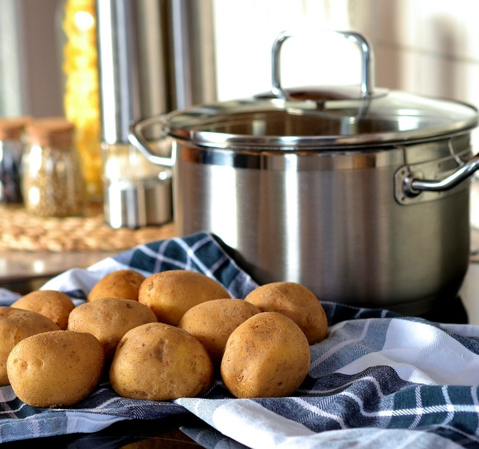 Kitchen; large steel pot and potatoes