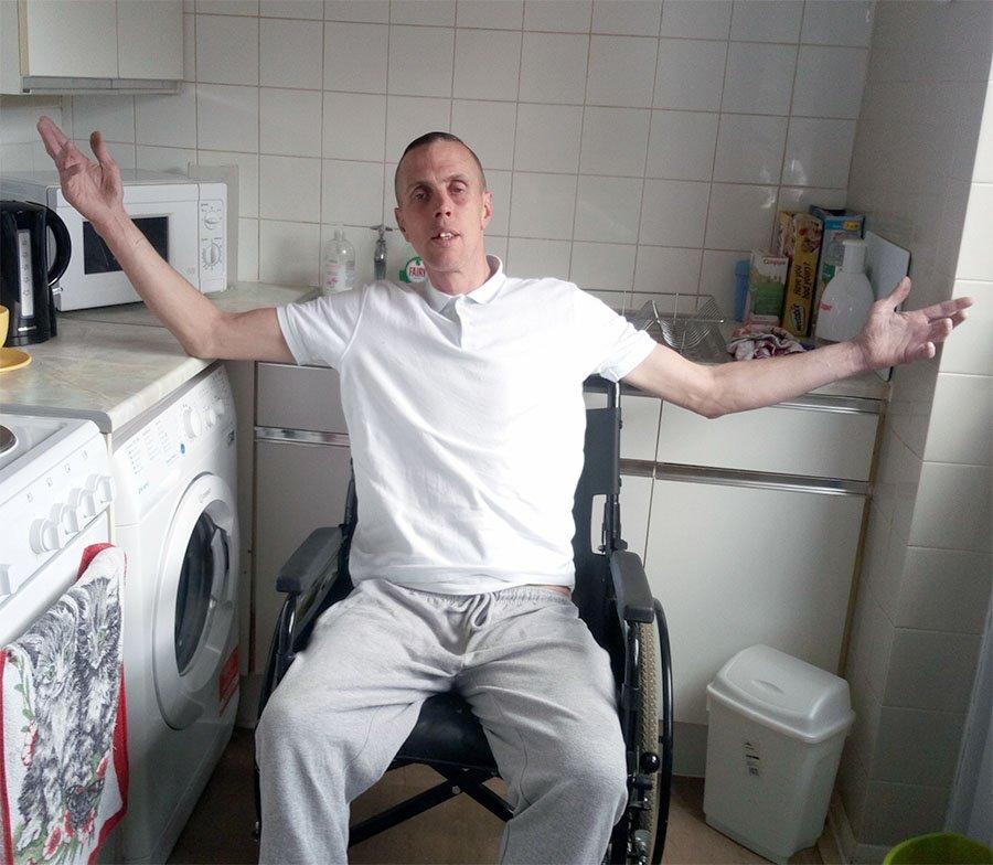 Man in wheelchair in kitchen